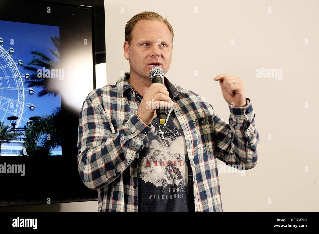 New York, NY - April 13:  Nik Wallenda, speaks at a press conference where he revealed his next feat will take place on April 29, 2015 at the soon-to-be-unveiled Orlando Eye, located in Orlando, Florida.. Wallenda will attempt to walk on top of the giant observation wheel without a tether and without a wire while it is moving. Standing 400 feet tall, the Orlando Eye forms part of the I-Drive 360 entertainment complex, which celebrates its grand opening this month and is located in the heart of OrlandoÔs newly revitalized International ÔI-DriveÔ District. The press conference took place on Apri Stock Photo