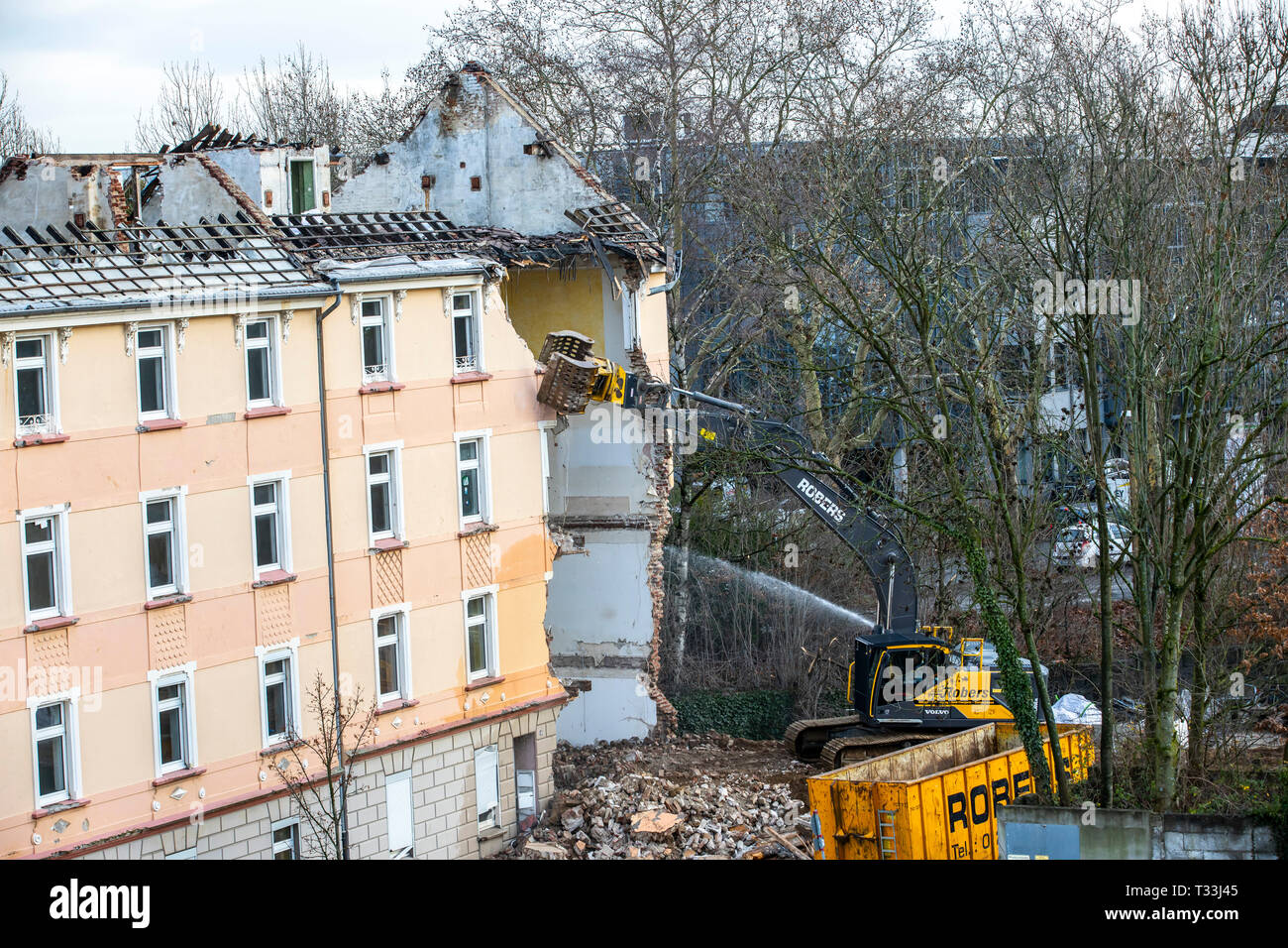 Demolition of an older residential building, this is where new rental apartments are being built, Stock Photo
