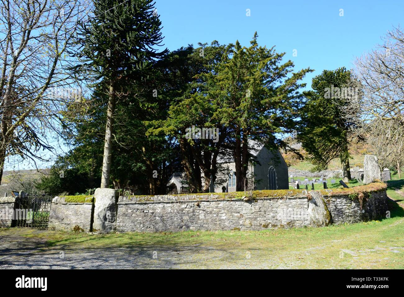 St Johns Church Ysbyty Cynfyn with a circular churchyard with a Bronze Age stone circle built into the surrounding wall  Cardiganshire Wales - Stock Image