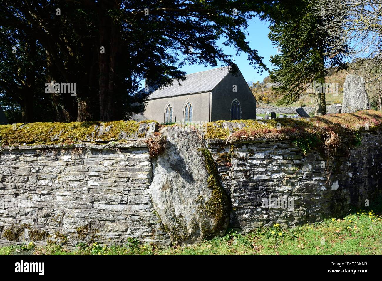 St Johns Church Ysbyty Cynfyn with a circular churchyard with a Bronze Age stone circle built into the surrounding wall  Cardiganshire Wales Stock Photo