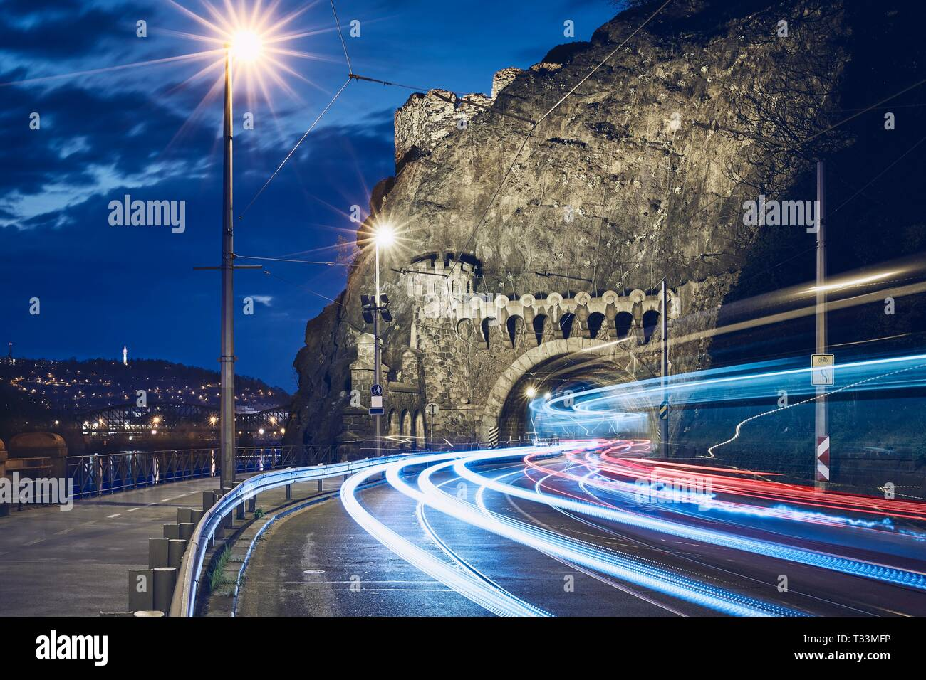 Night traffic in city. Light trails of tram and cars on road to Vysehrad tunnel.  Prague, Czech Republic Stock Photo