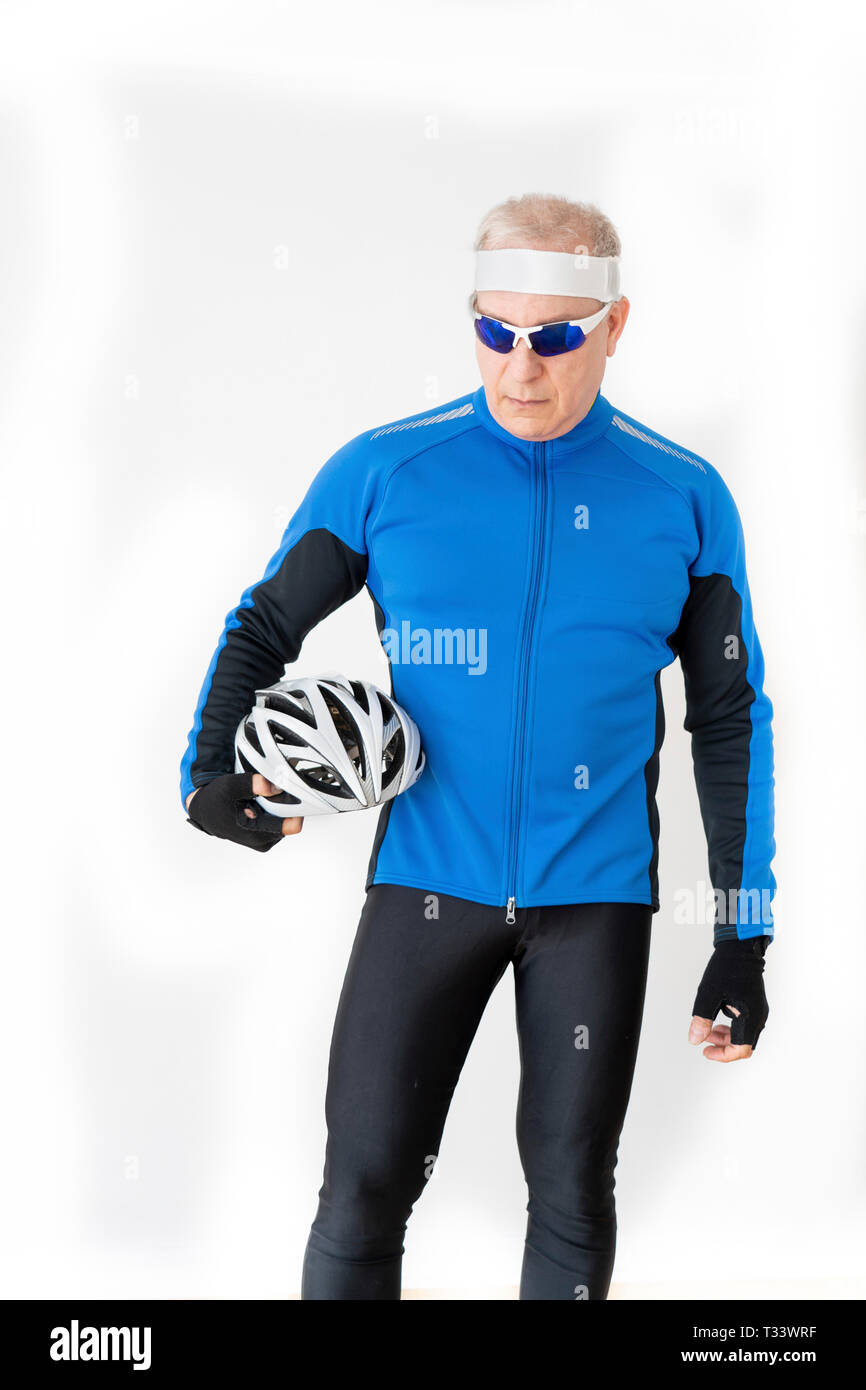 60 year old male in his biking outfit - Stock Image