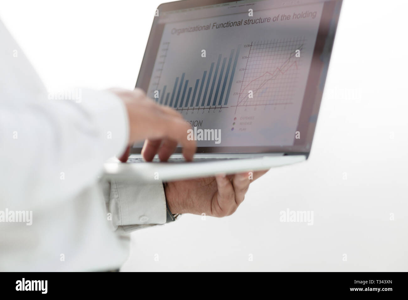 close up. a businessman uses a laptop to work with financial data. - Stock Image