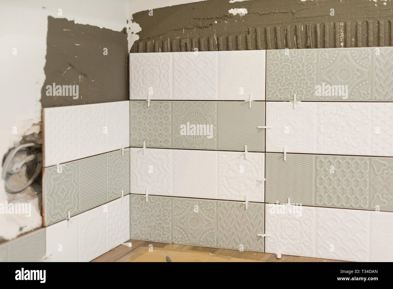 Process Of Laying Ceramic Tiles Construction And Repair In The Kitchen Tiles Stock Photo Alamy