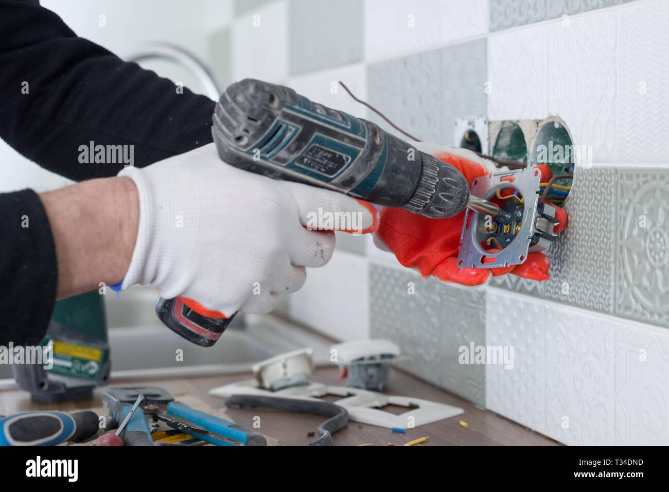 Renovation and construction in kitchen, close-up of ... on standard 220 volt outlet, usb wall outlet, cable tv outlet, installing wall outlet, usb plug outlet, 240 volt outlet, installing outlet box, installing recessed tv outlet, installing outlet in vehicles, installing electrical outlets,