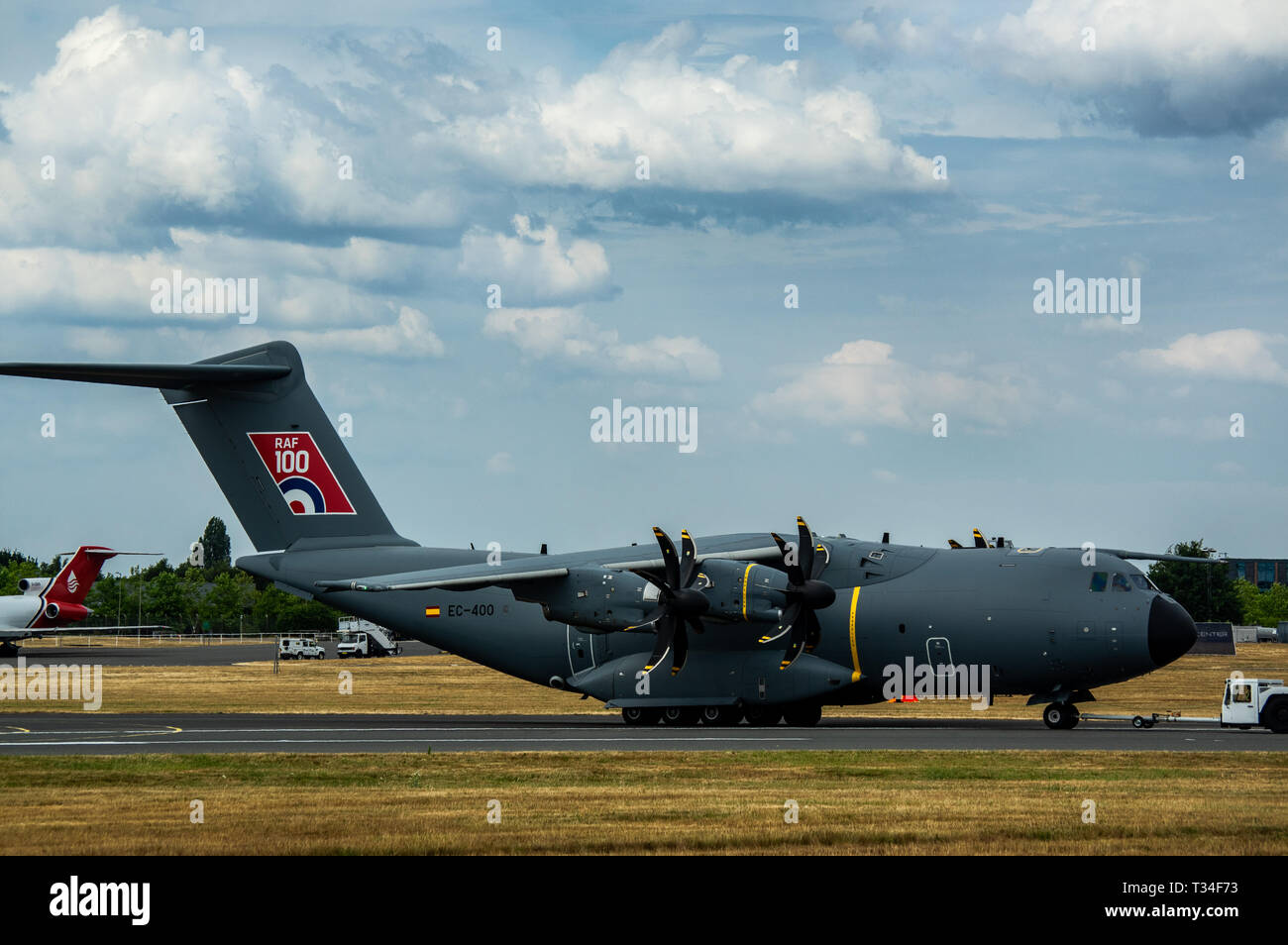 An Airbus A400M Atls being pulled by a tractor at the Farnborough air show 2018 - Stock Image