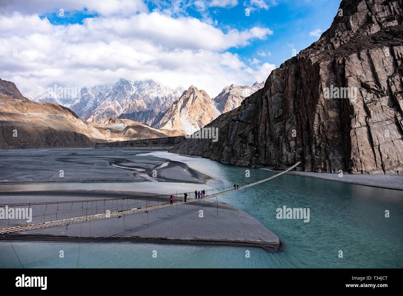 People crossing the Hussaini Hanging Bridge, Hunza, Gilgit-Baltistan, Pakistan - Stock Image