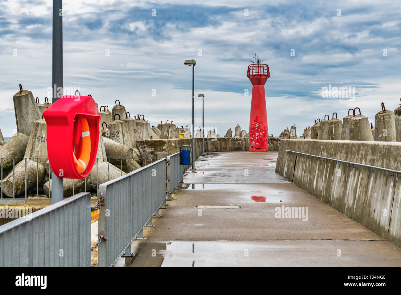 The Red Lighthouse is a so-called pier light and marks the entrance to the harbor of Kolobrzeg, West Pomerania, Poland, Europe - Stock Image
