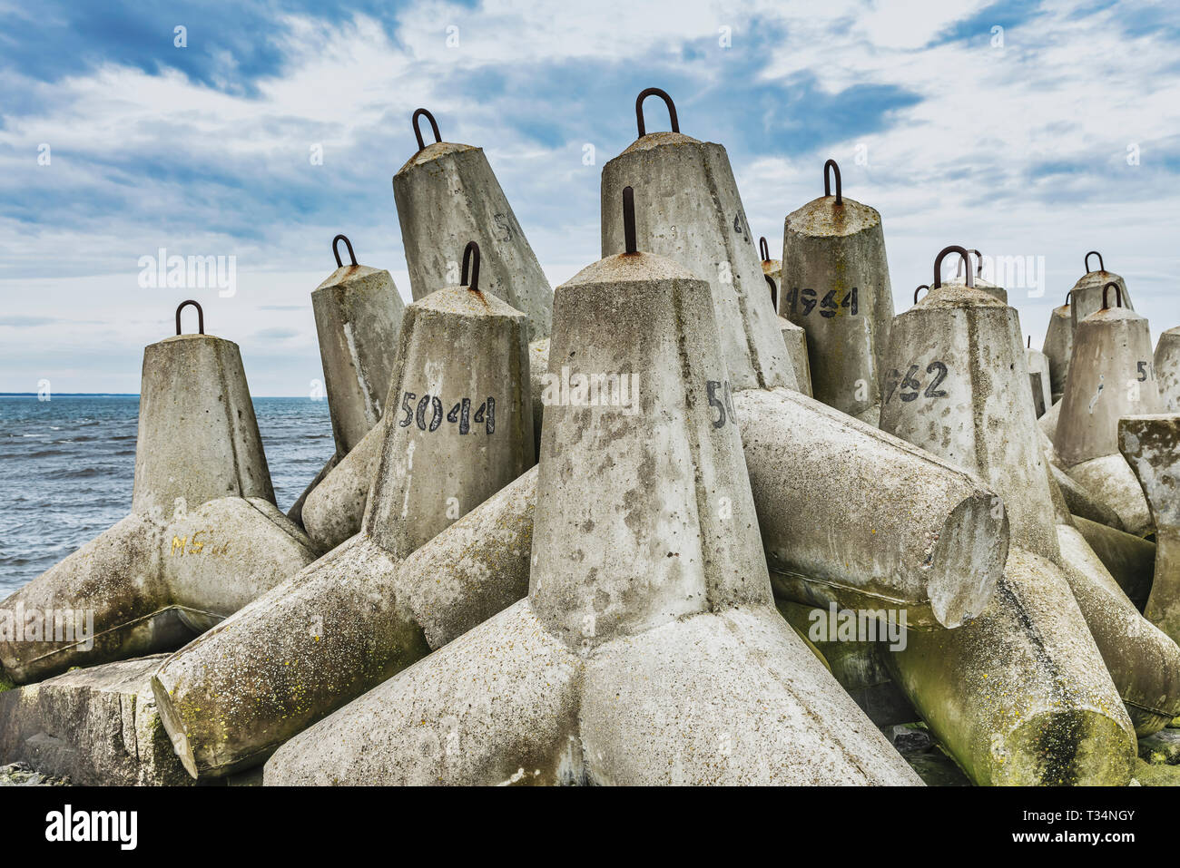 Tetrapods are concrete blocks used in coastal protection structures. - Stock Image