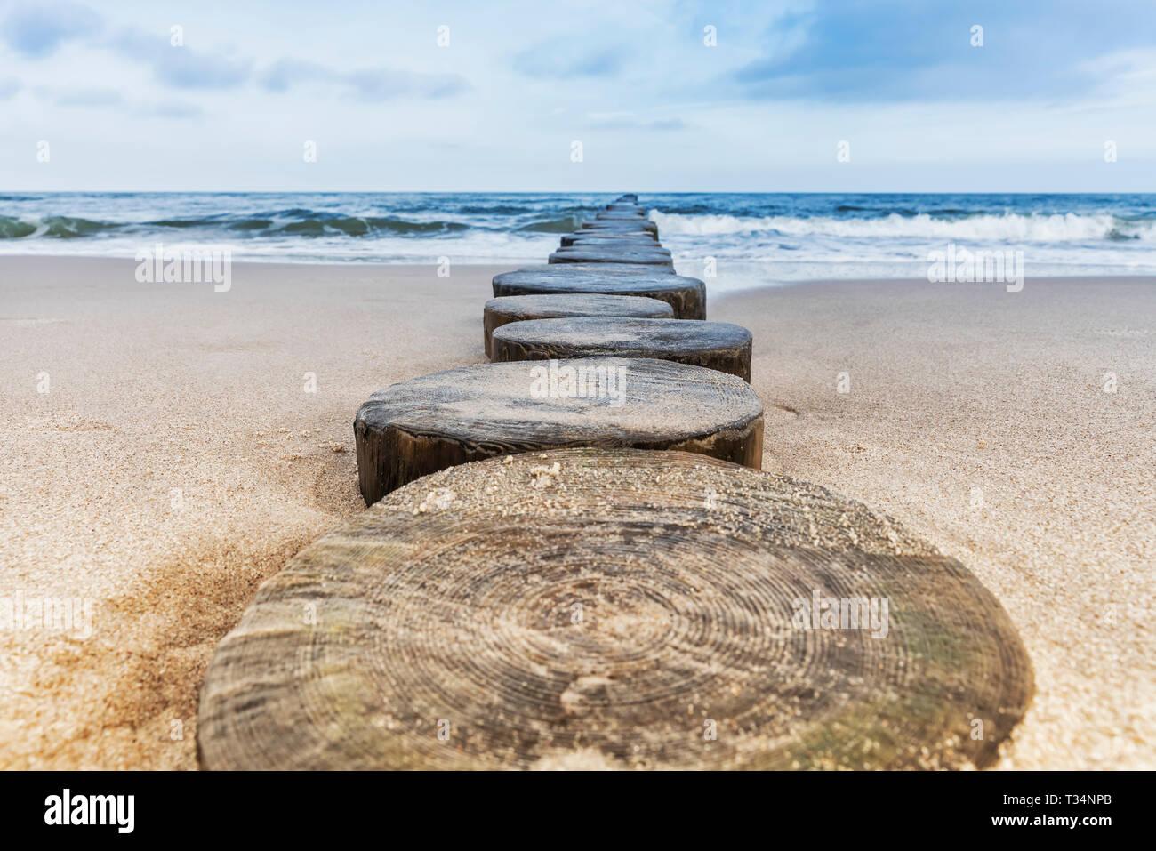 Groynes at the beach of the Baltic Sea in Kolobrzeg, West Pomeranian, Poland, Europe Stock Photo