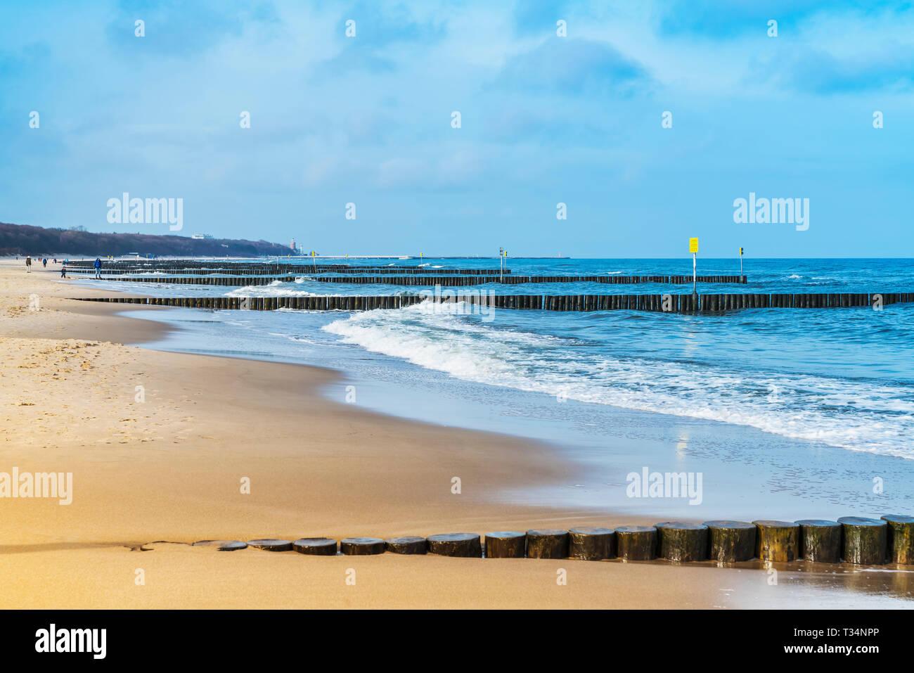 Sandy Beach with groynes on the Baltic Sea, Kolobrzeg, West Pomeranian, Poland, Europe Stock Photo