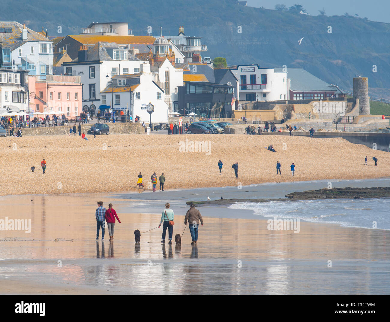Lyme Regis, Dorset, UK. 6th April 2019. UK Weather:  Visitors and locals enjoyed a breezy day with plenty of bright sunny spells at the picturesque seaside resort of Lyme Regis.  Credit: Celia McMahon/Alamy Live News - Stock Image