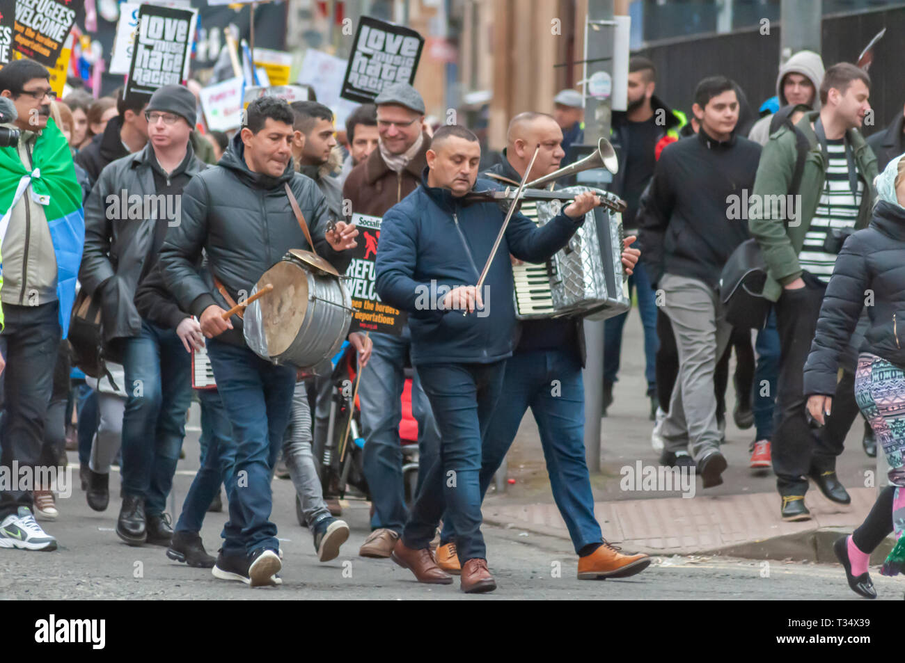 Glasgow, Scotland, UK. 6th April, 2019: Musicians marching during the annual International Roma Day community procession through the streets of Govanhill to celebrate Romani culture and raise awareness of the issues facing Romani people. Credit: Skully/Alamy Live News - Stock Image