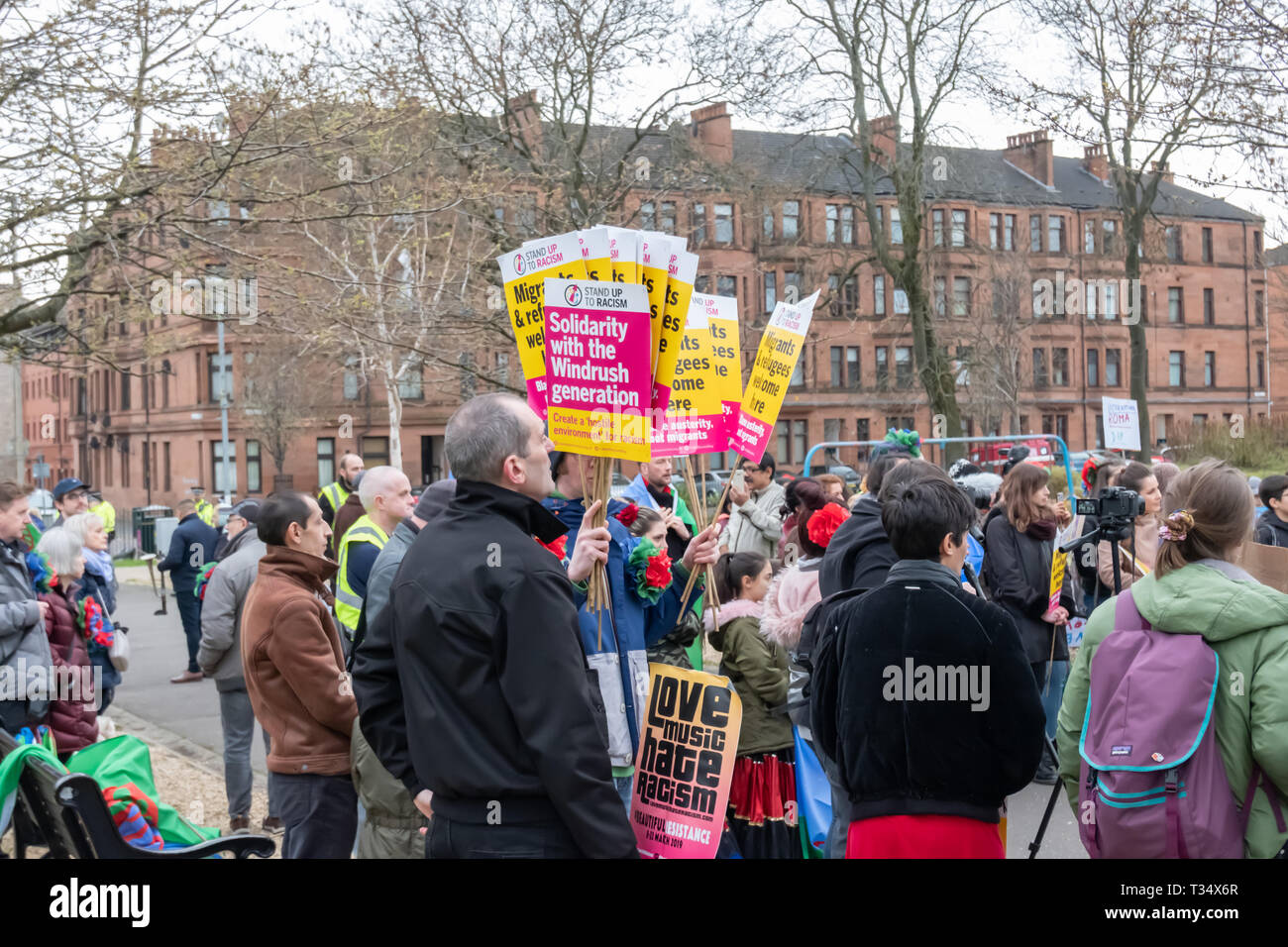 Glasgow, Scotland, UK. 6th April, 2019: Marchers gather at the start of the annual International Roma Day community procession through the streets of Govanhill to celebrate Romani culture and raise awareness of the issues facing Romani people. Credit: Skully/Alamy Live News - Stock Image