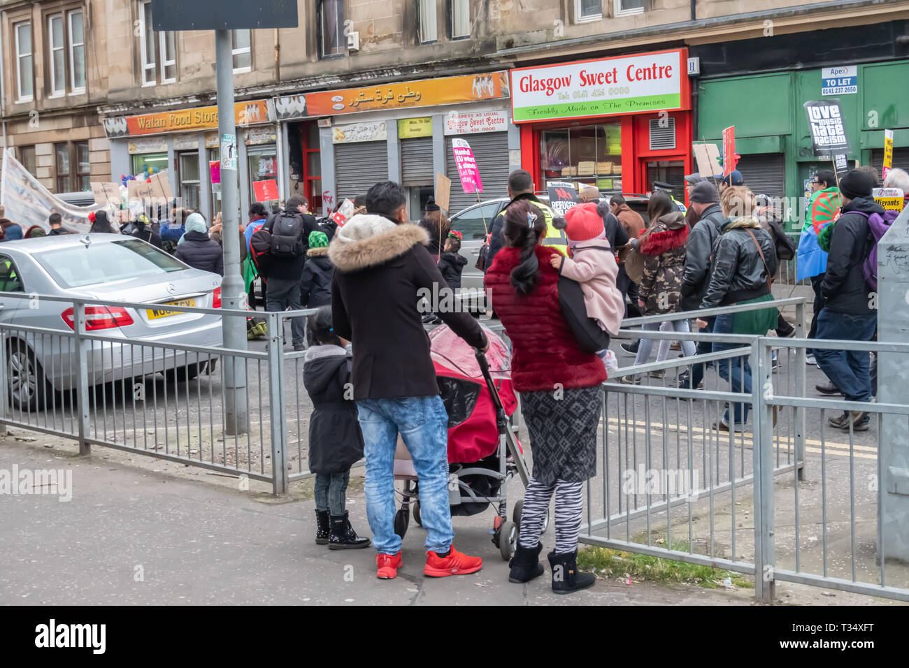 Glasgow, Scotland, UK. 6th April, 2019: Spectators watching the annual International Roma Day community procession through the streets of Govanhill to celebrate Romani culture and raise awareness of the issues facing Romani people. Credit: Skully/Alamy Live News - Stock Image