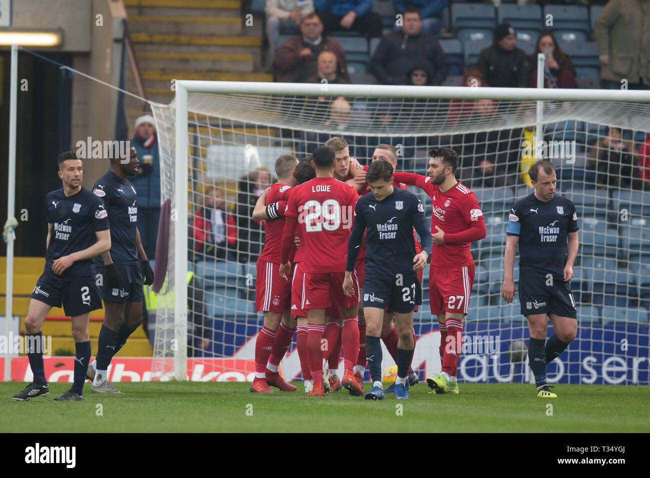 Dens Park, Dundee, UK. 6th Apr, 2019. Ladbrokes Premiership football, Dundee versus Aberdeen; Sam Cosgrove of Aberdeen is congratulated after scoring for 1-0 Credit: Action Plus Sports/Alamy Live News - Stock Image