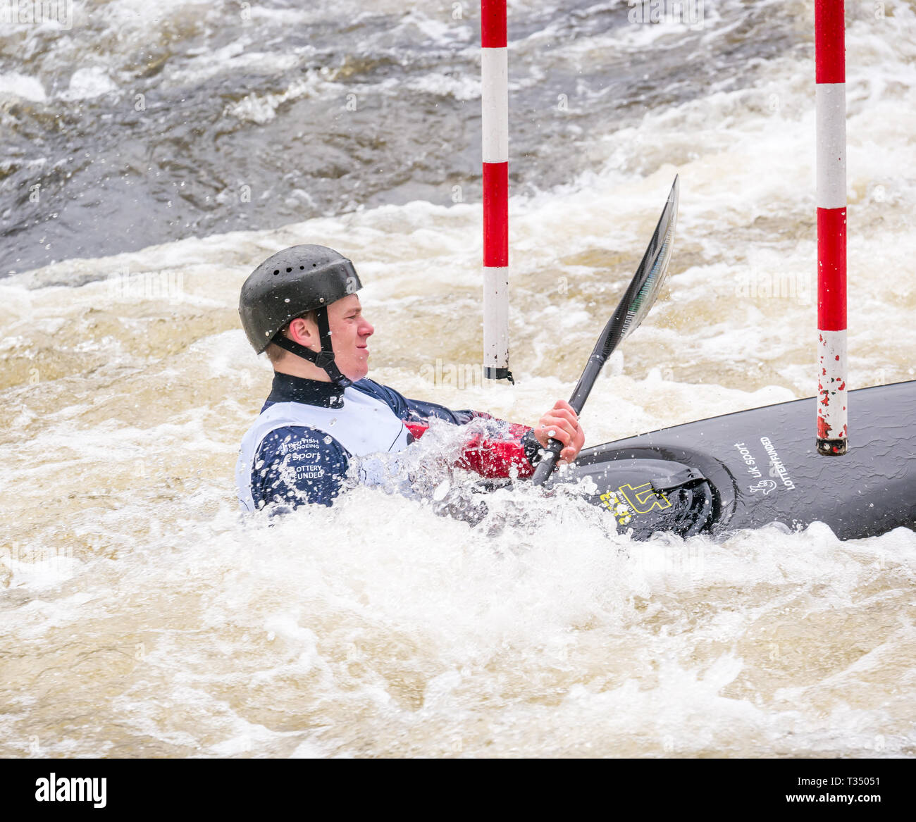 Grandtully, Perthshire, Scotland, United Kingdom, 6 April 2019. Grandtully Premier Canoe Slalom: Danny Taylor from Viking Kayak Club competes in the men's premier kayak on the River Tay - Stock Image