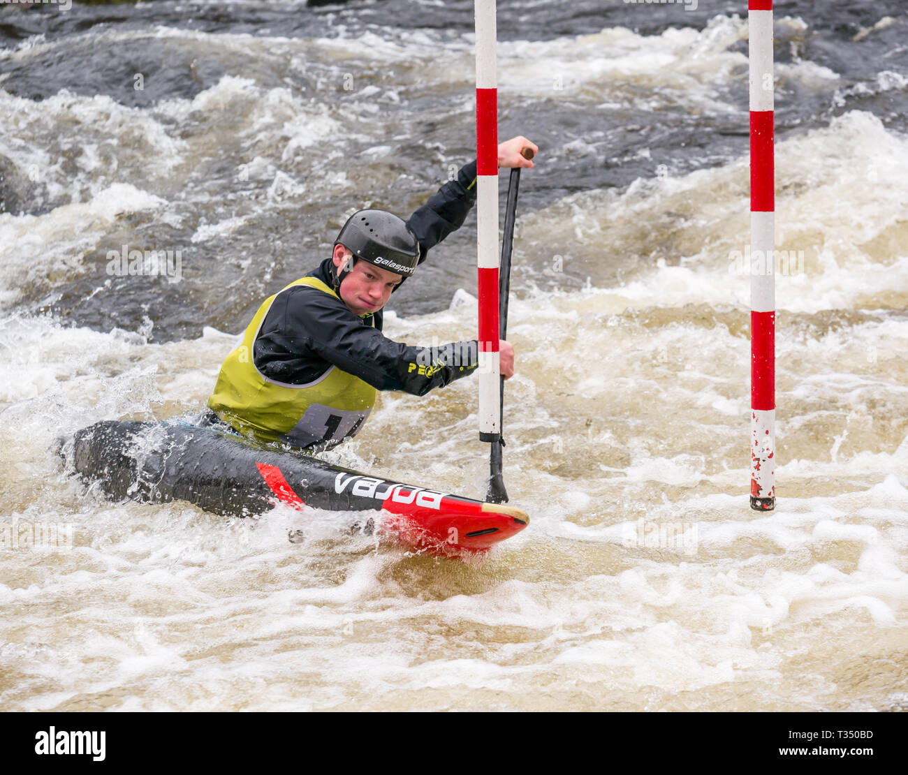 Grandtully, Perthshire, Scotland, United Kingdom, 6 April 2019. Grandtully Premier Canoe Slalom:  Robert Fernie from Holme Pierrepoint canoe club competes in the men's premier Canadian canoe  on the River Tay - Stock Image