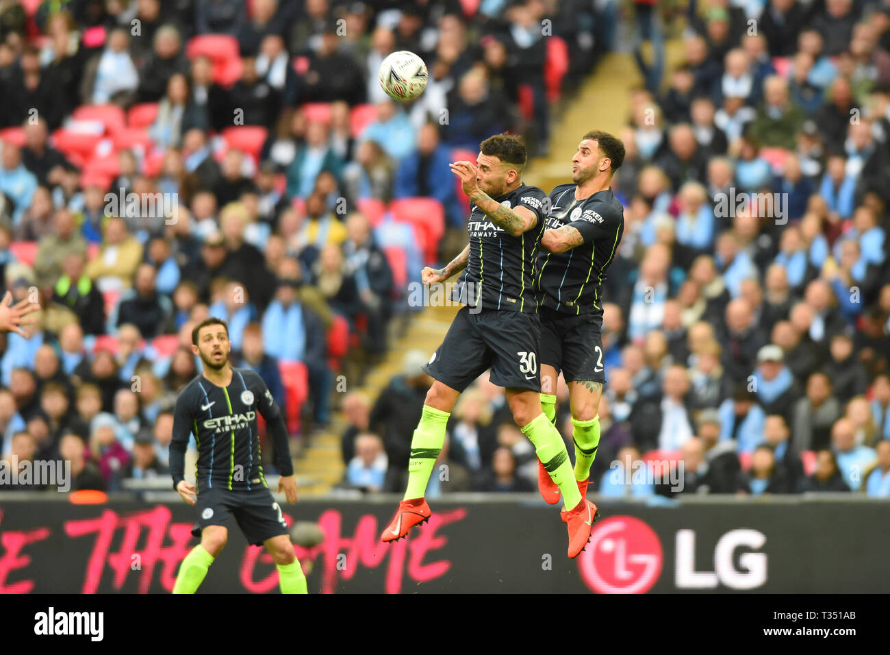 London, UK. 6th Apr, 2019. Manchester City defender Nicolas Otamendi and Kyle Walker head the same ball during the FA Cup Semi Final between Brighton and Hove Albion and Manchester City at Wembley Stadium, London on Saturday 6th April 2019. (Credit: Jon Bromley | MI News) Editorial use only, license required for commercial use. No use in betting, games or a single club/league/player publications. Photograph may only be used for newspaper and/or magazine editorial purposes. Credit: MI News & Sport /Alamy Live News Stock Photo