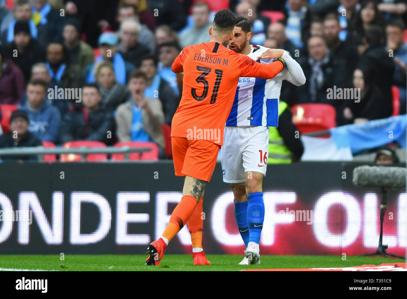 London, UK. 6th Apr, 2019. Manchester City goalkeeper Ederson Moraes holds Brighton forward Alireza Jahanbakhsh back during the FA Cup Semi Final between Brighton and Hove Albion and Manchester City at Wembley Stadium, London on Saturday 6th April 2019. (Credit: Jon Bromley | MI News) Editorial use only, license required for commercial use. No use in betting, games or a single club/league/player publications. Photograph may only be used for newspaper and/or magazine editorial purposes. Credit: MI News & Sport /Alamy Live News Stock Photo