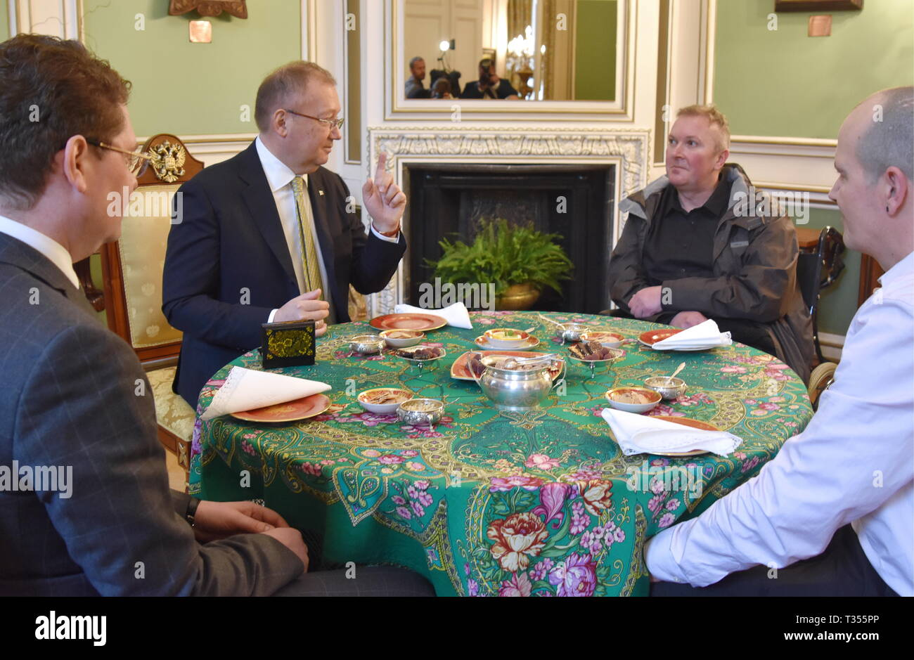 London, UK. 06th Apr, 2019.  UK citizen Charles Rowley, his brother Matthew Rowley, and Russian Ambassador to the UK Alexander Yakovenko (L-R) drink tea during a meeting at the Russian Embassy in London. Charles Rowley and his partner Dawn Sturgess were hospitalised on June 30, 2018, in Amesbury; Ms Sturgess died on July 8. The couple was reportedly exposed to the Novichok poison, the same nerve agent that was used to poison former Russian military intelligence officer Sergei Skripal and his daughter Yulia in Salisbury months before. Ilya Dmitryachev/TASS Credit: ITAR-TASS News Agency/Alamy Li Stock Photo