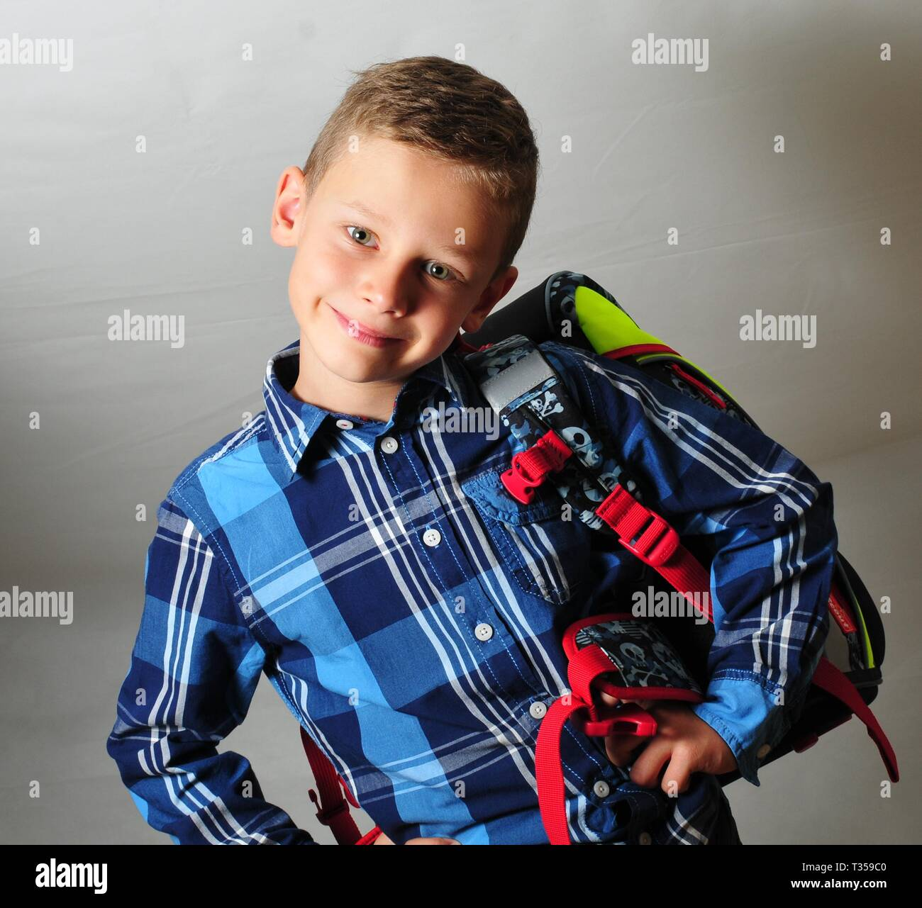 happy smiling boy carry a schoolbag preschool - Stock Image
