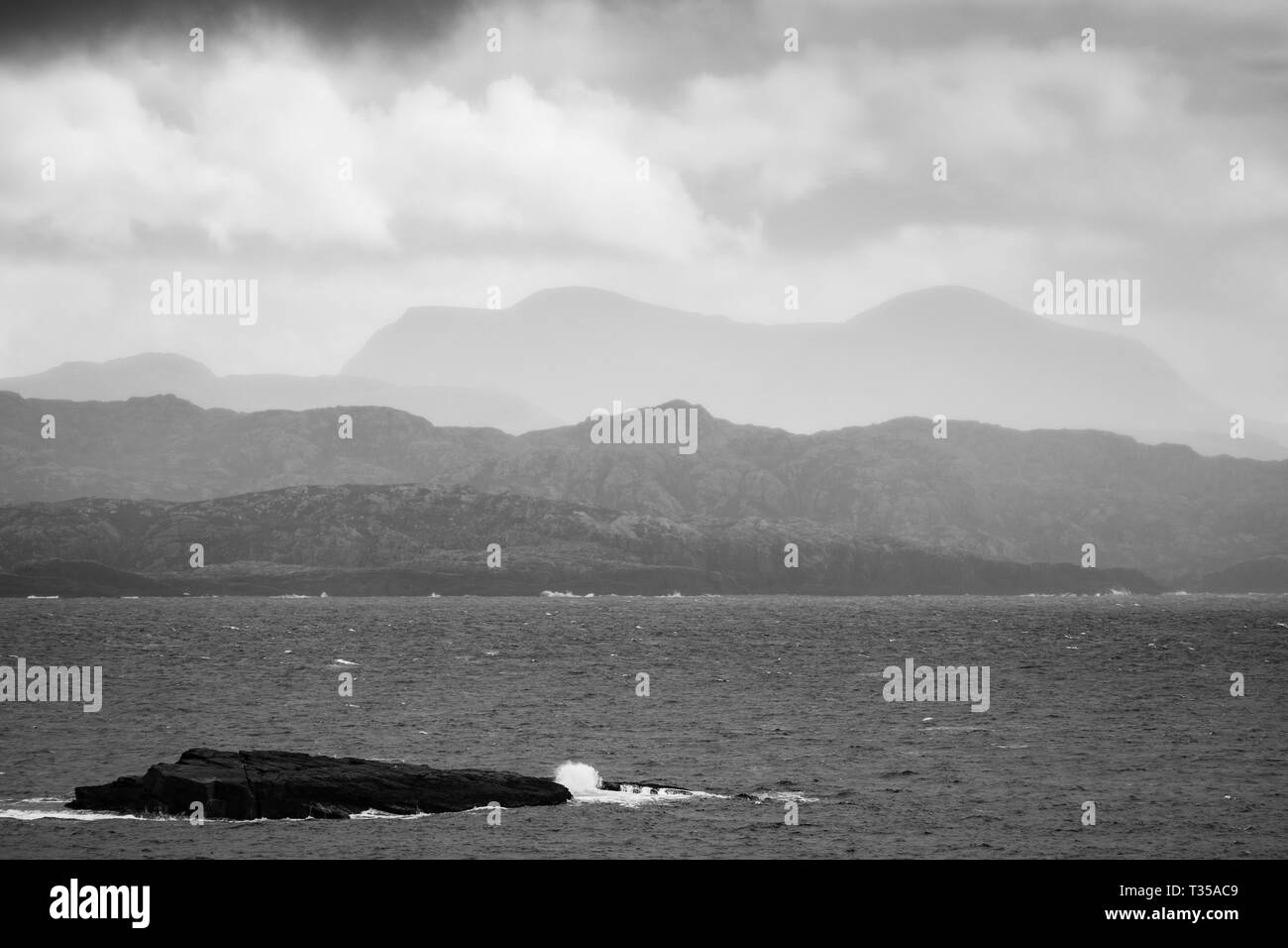 Sheathed in mist and fog, the mountain Foinaven is seen here as viewed from Blairmore, Sutherland, northern Scotland. - Stock Image