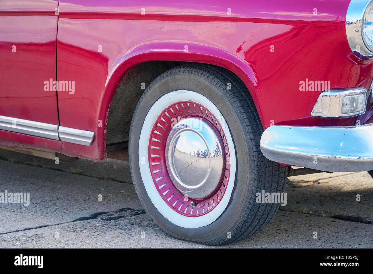 Wheel and bumper of red vintage car - Stock Image