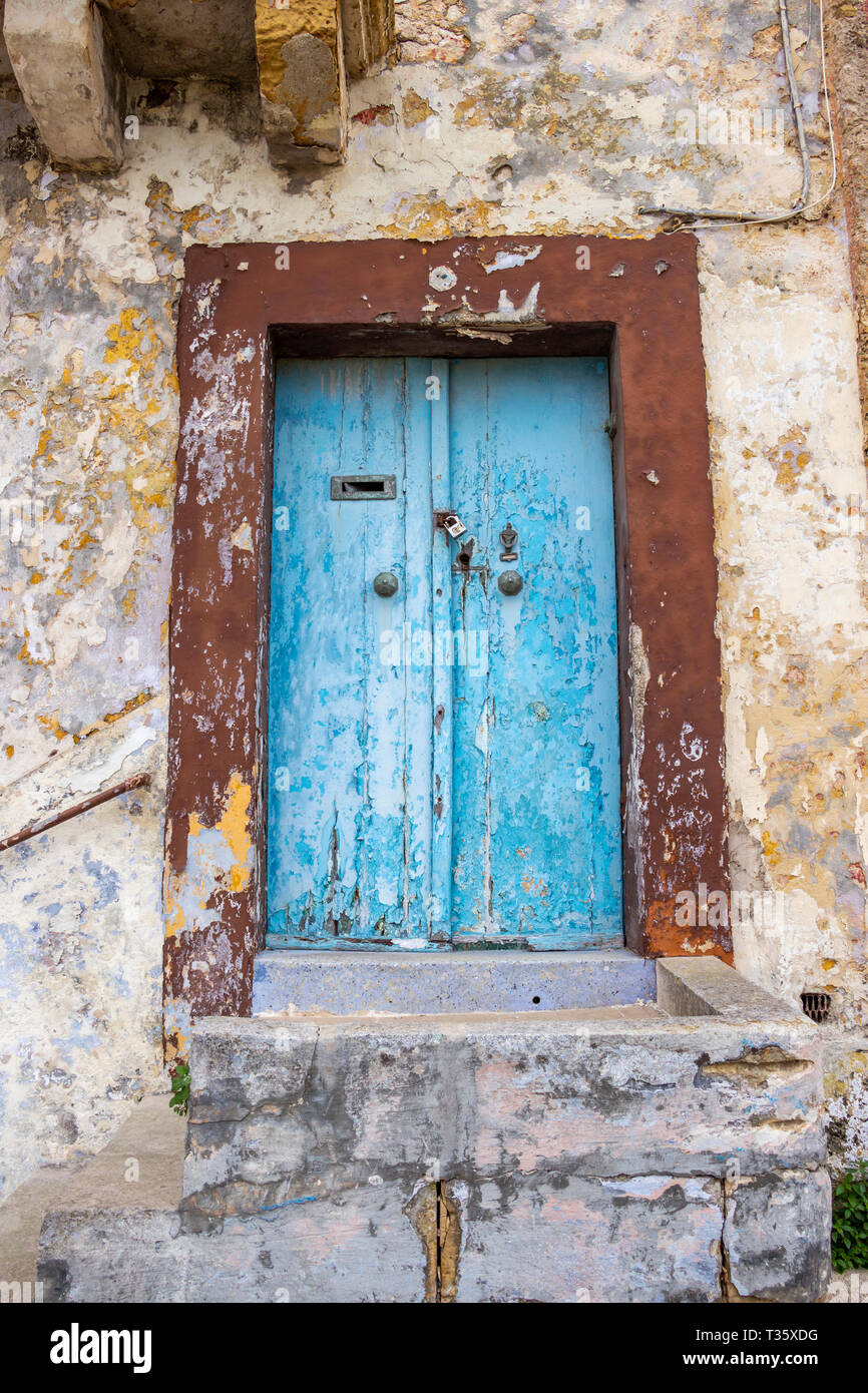 Beautiful old, light blue painted, weathered, locked door of an abandoned building at Rabat, Malta Stock Photo