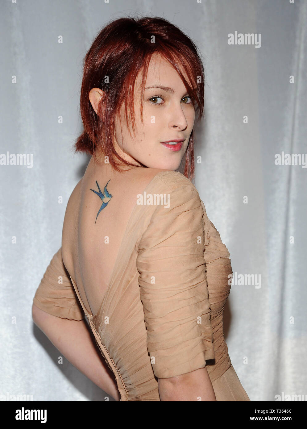 Alyssa Milano Tattoos Removed headshot smile eye contact over the shoulder tattoo stock