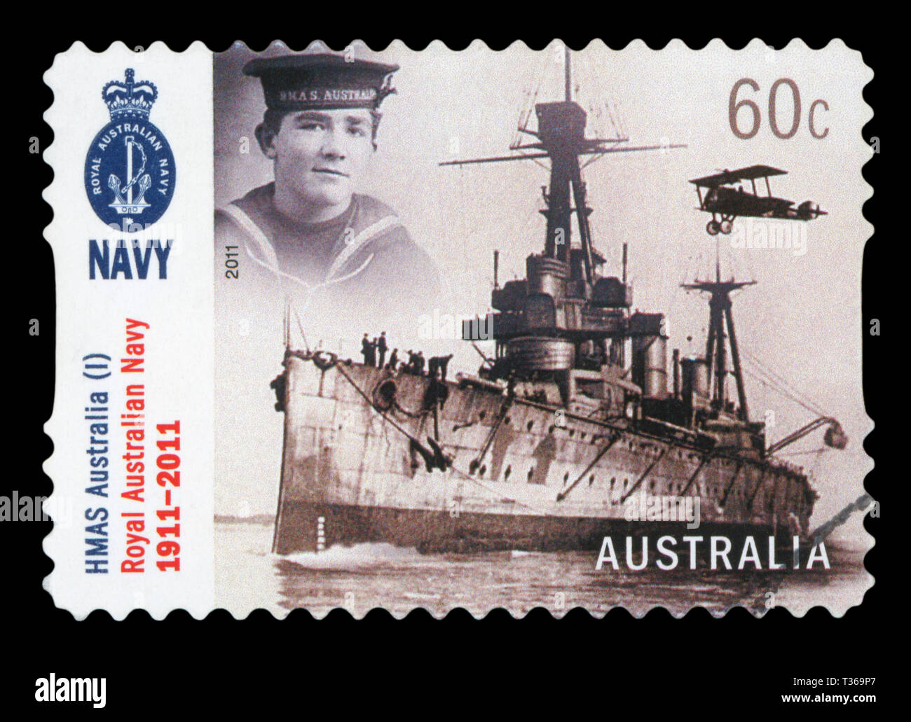 AUSTRALIA - CIRCA 2011: A used postage stamp from Australia, depicting an image of HMAS Australia I, one of three battleships built for the defence of - Stock Image
