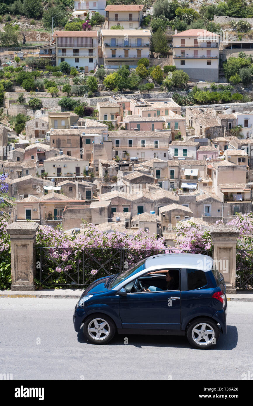 Compact blue small city car in the hill city of Modica Alta famous for its Baroque architecture, South East Sicily Stock Photo