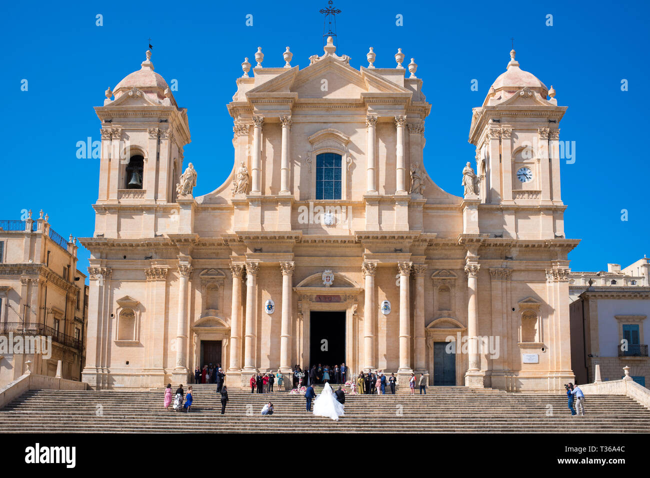 Bride arriving for wedding at Baroque style Cathedral of Saint Nicholas in Noto city, South East Sicily, Italy Stock Photo