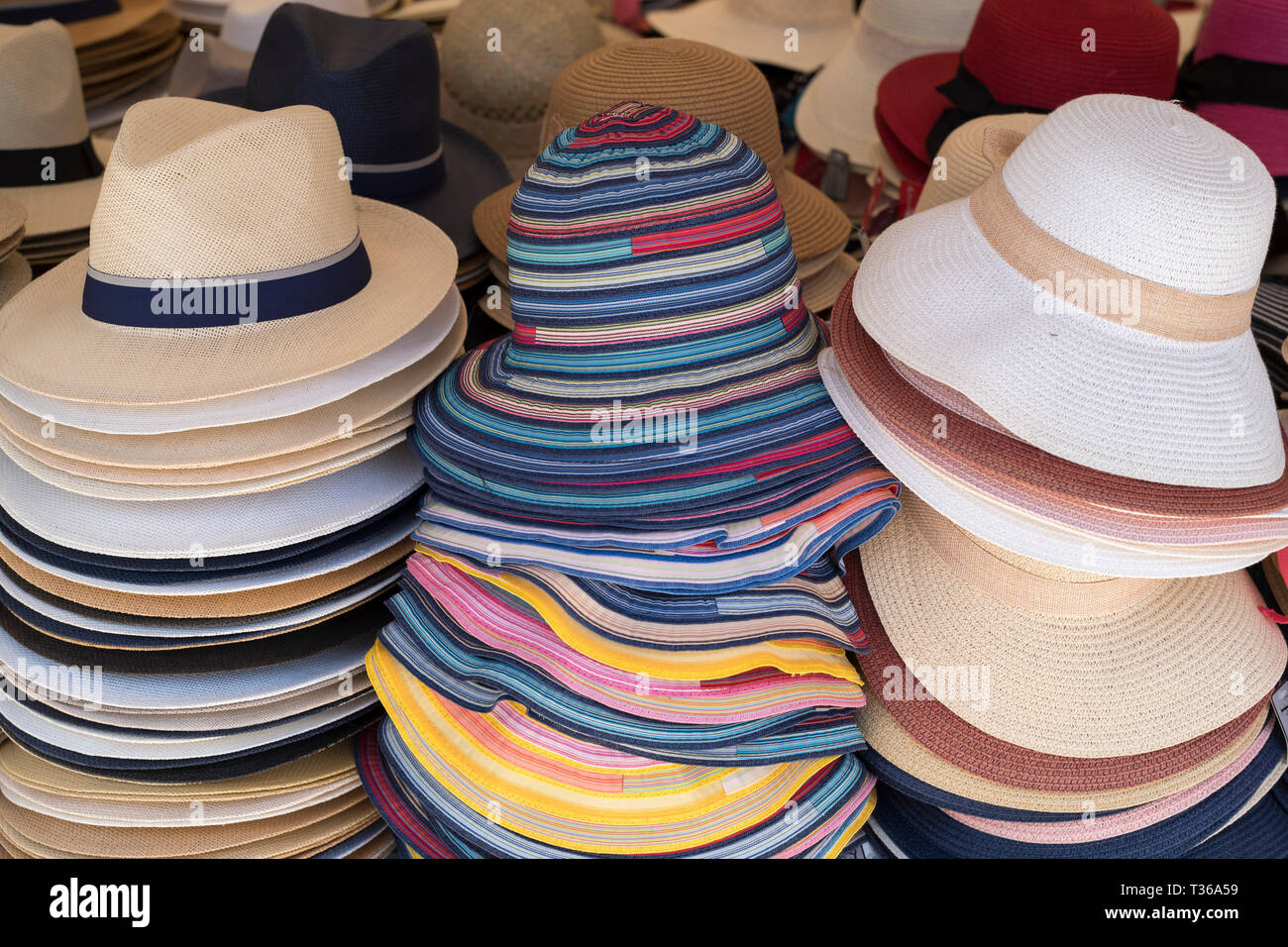 b08009af8ddc34 Panama and straw sun hats on display for sale on market stall at the old  street market - Mercado - in Ortigia, Syracuse, Sicily