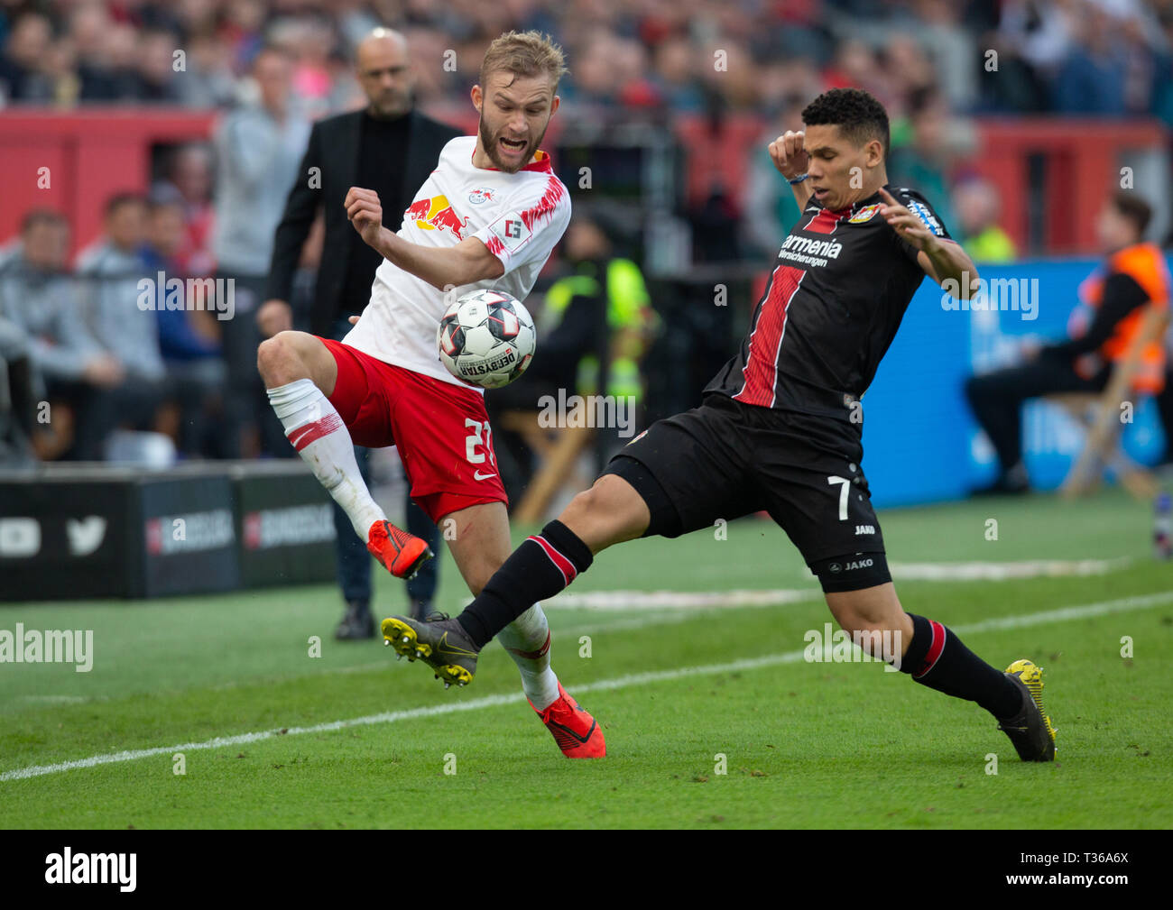 Leverkusen, Germany, April 6 2019, Bundesliga, Bayer 04 Leverkusen vs RB Leipzig: Konrad Laimer (Leipzig), Paulinho (B04) in competition.              - Stock Image
