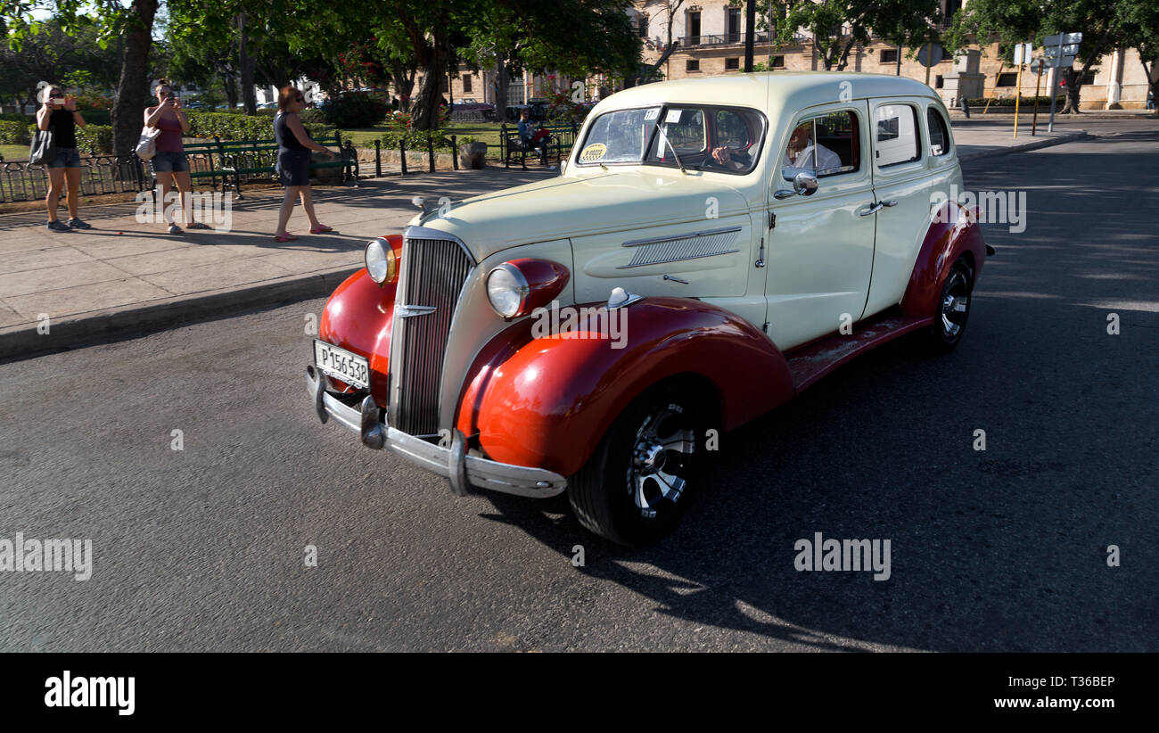 1937 Chevy Station Wagon driving on streets of Havana, Cuba - Stock Image