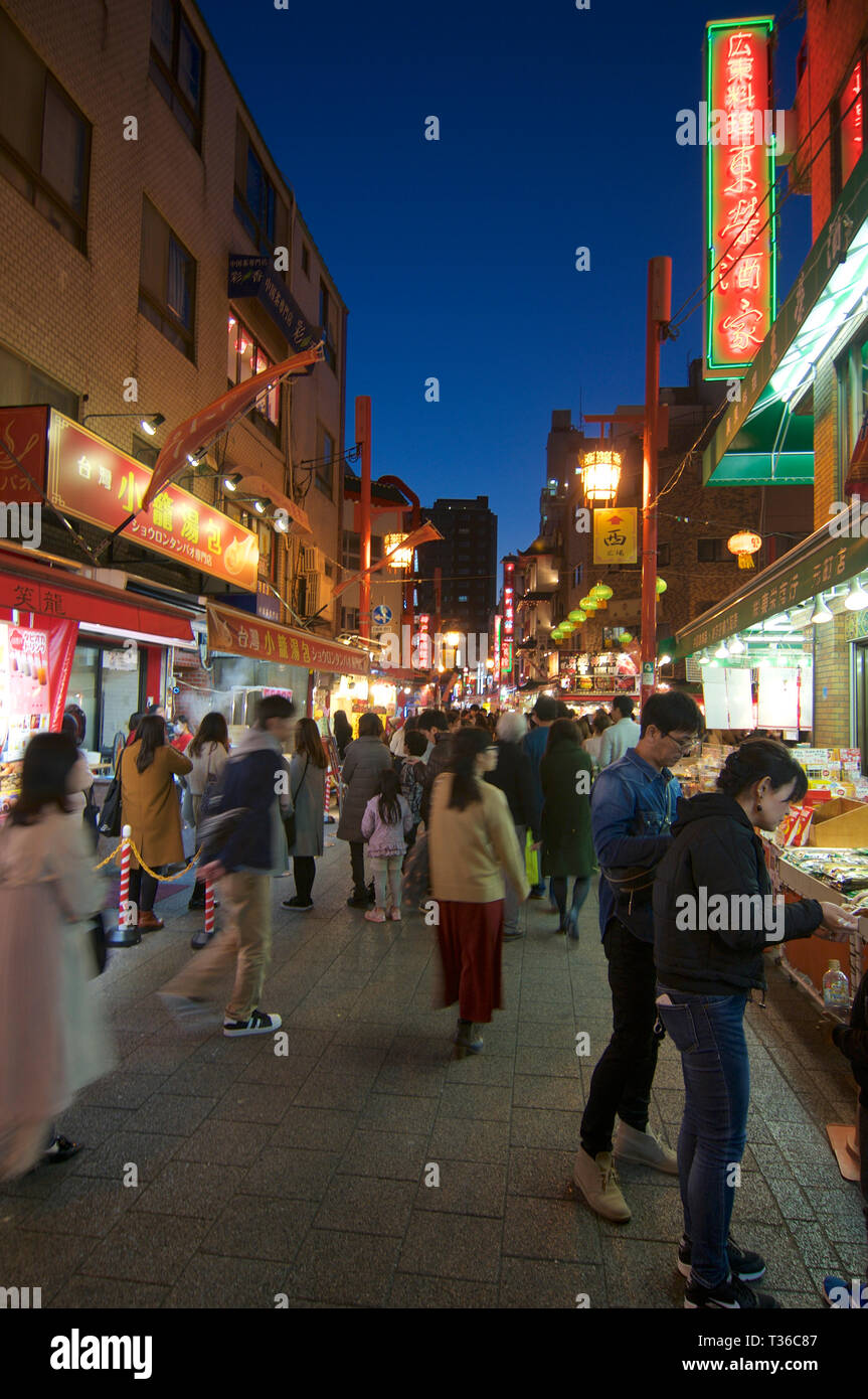 Kobe, Hyogo, Japan - 17th November 2018 : View of the busy street of Kobe's Chinatown at night in the Nankinmachi area in Kobe, Japan - Stock Image