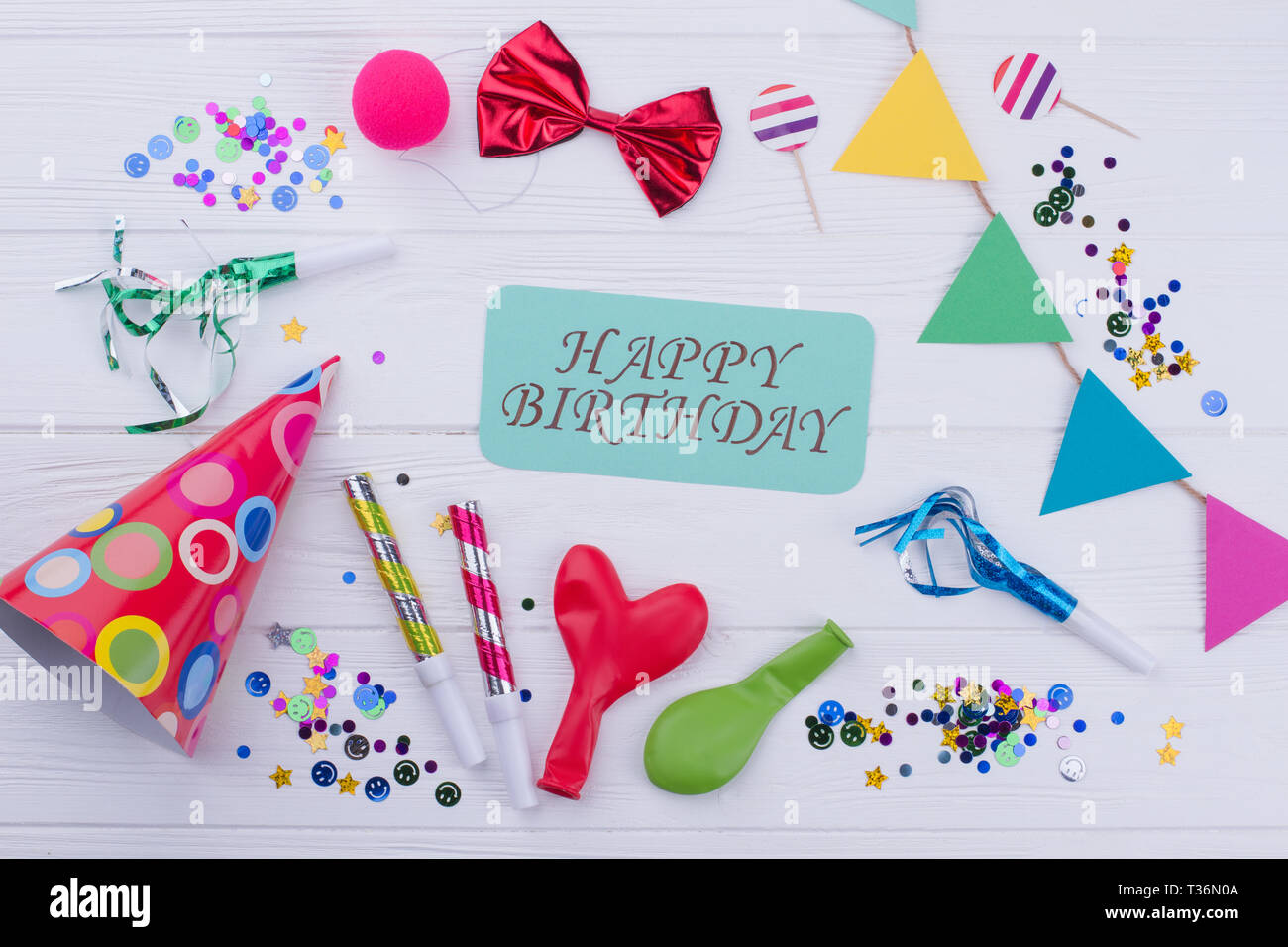 Accessories For Kids Birthday Party On A Wooden Background