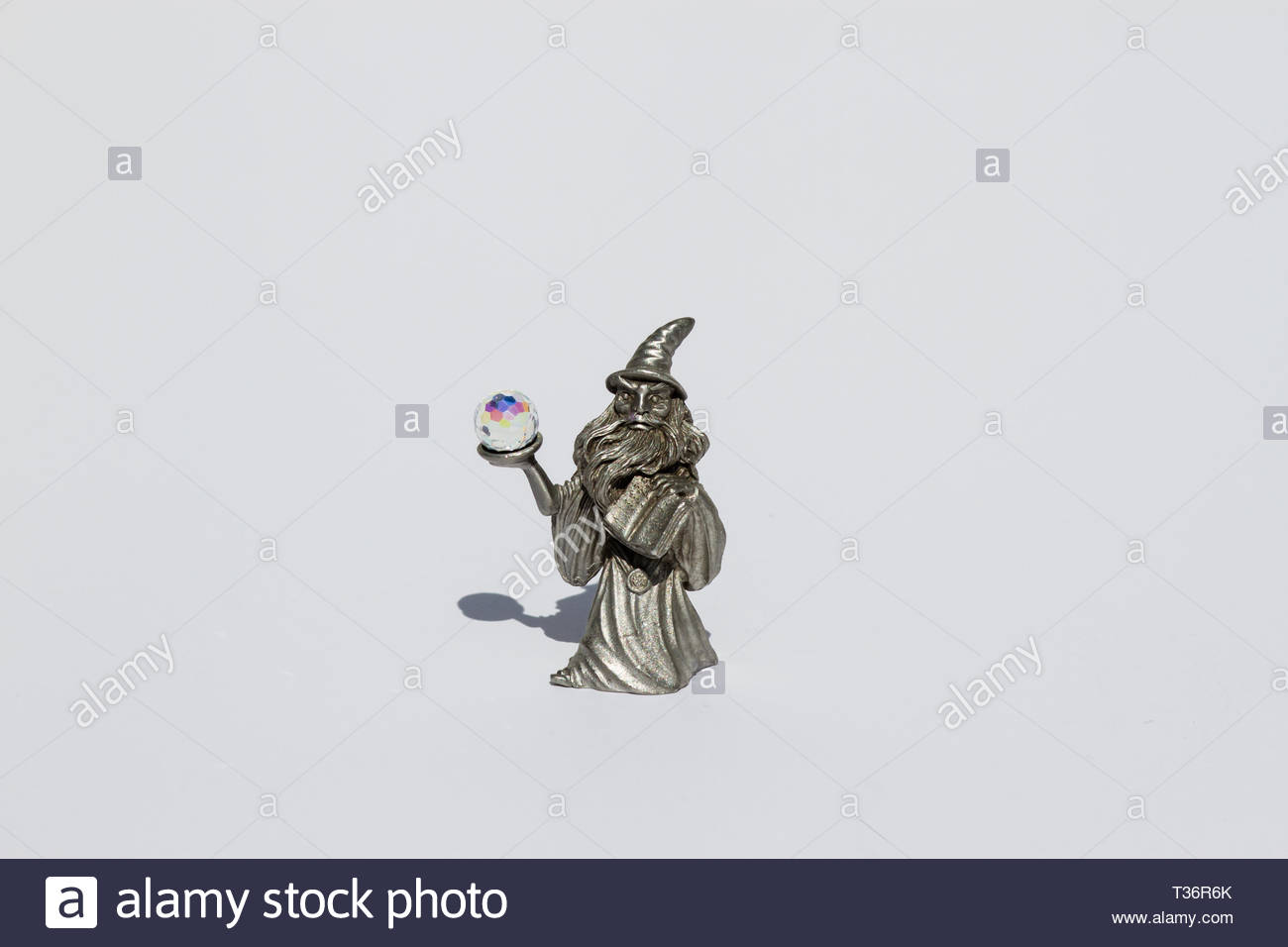 Pewter wizard figurine with a crystal ball  Resembles