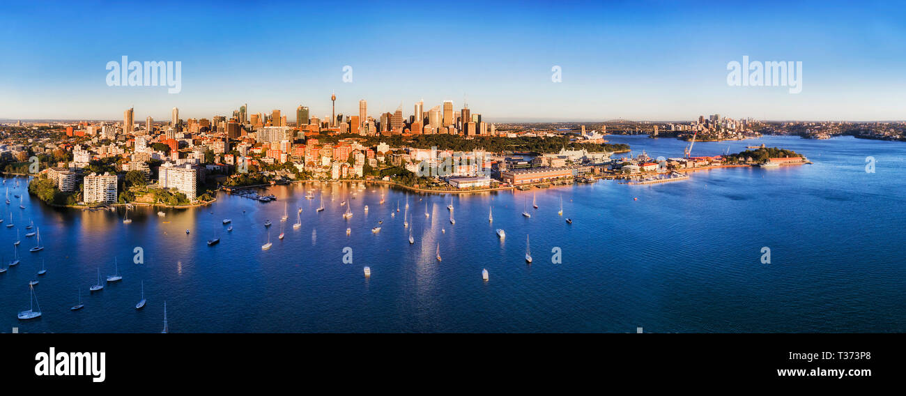 Sydney city CBD landmarks on waterfront of Sydney harbour in aerial view from Potts point over Darling point and Woolloomooloo. - Stock Image