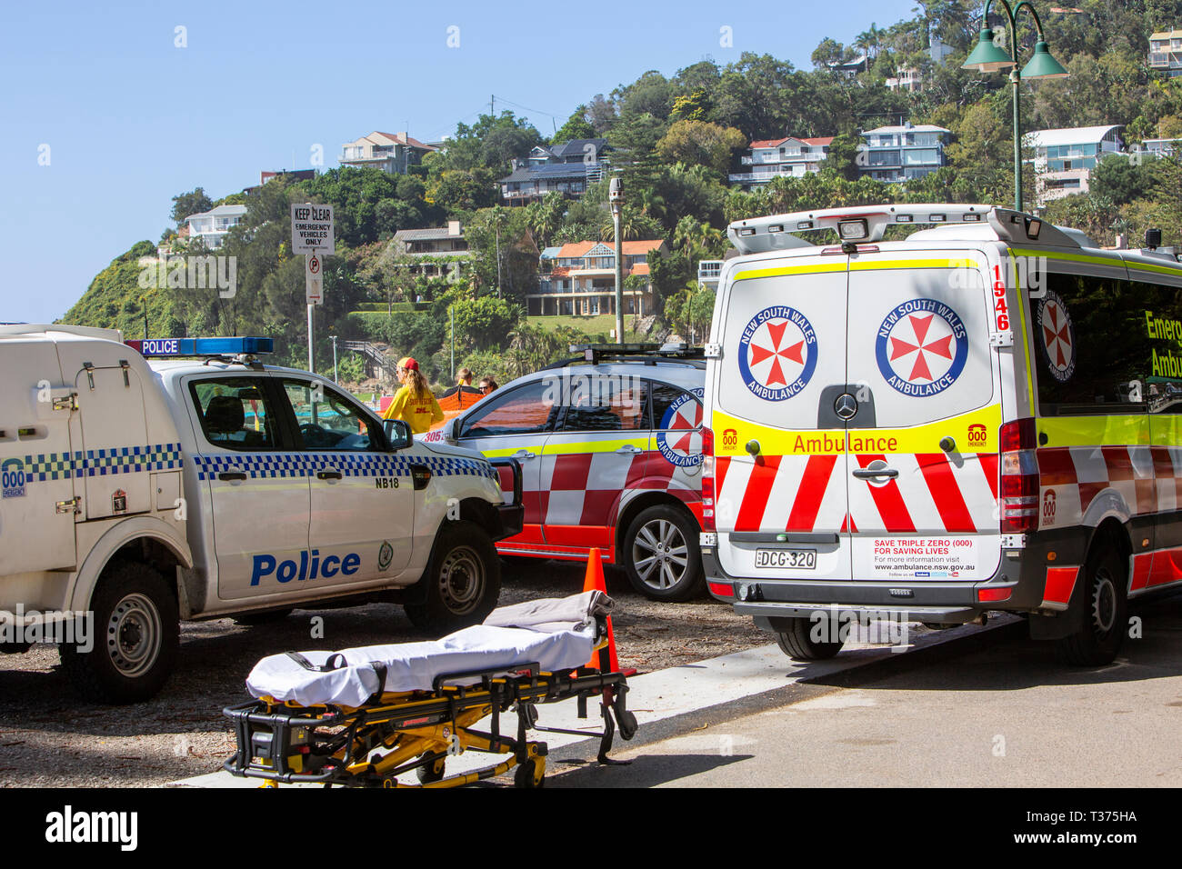 Sydney ambulance and police car at Palm beach to recover a patient who was rescued from near drowning,Australia Stock Photo