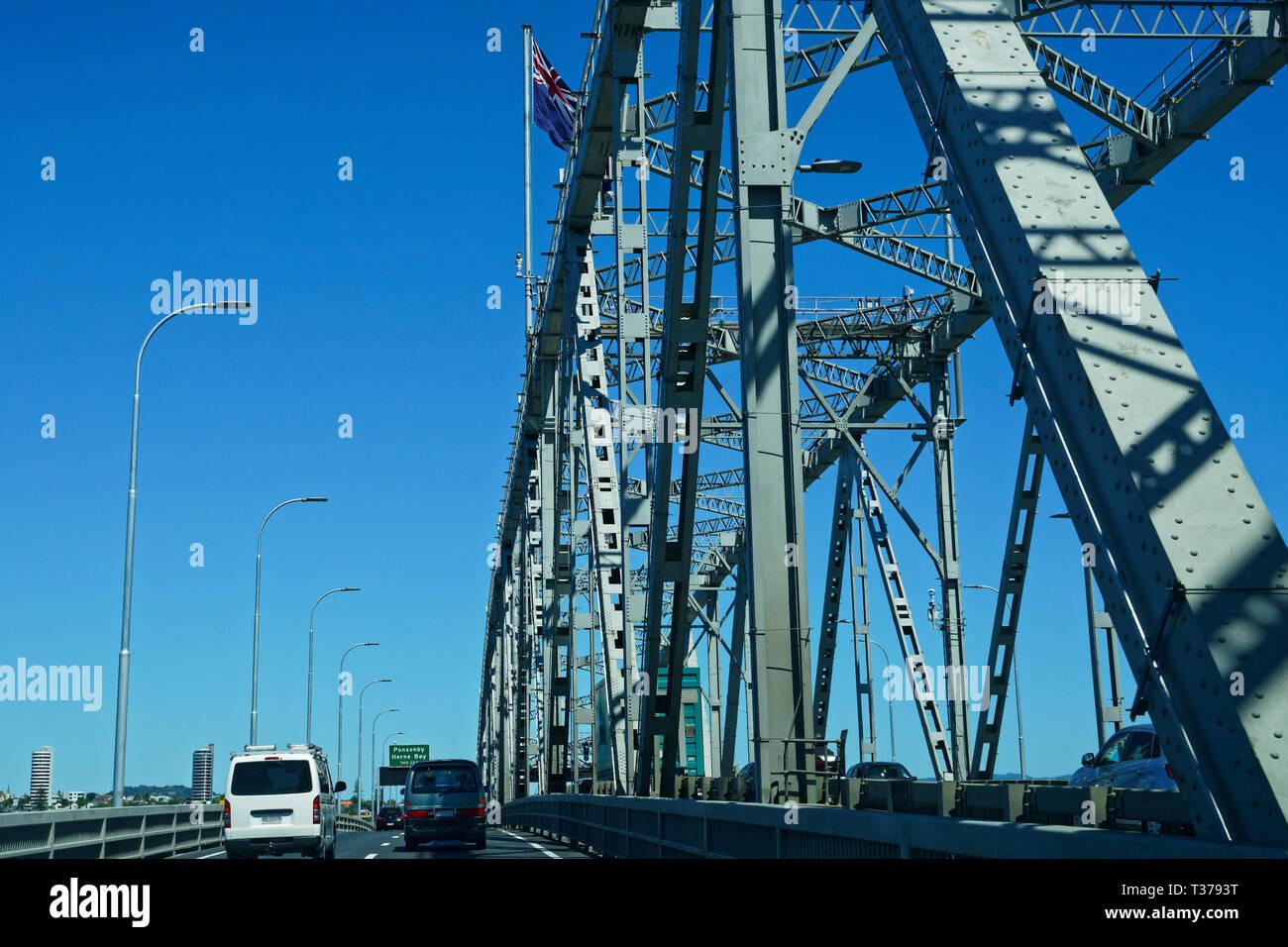 Travelling on Auckland Harbour Bridge, New Zealand. - Stock Image
