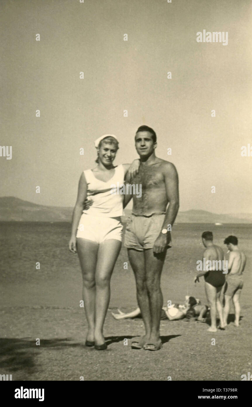 Barechested Man and woman at the beach, Italy 1960s - Stock Image