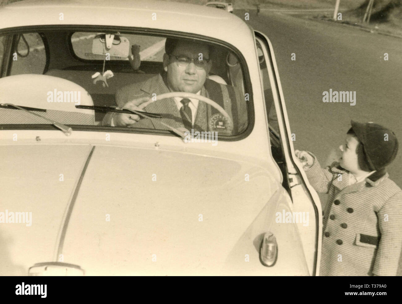 Father and son with the car, Italy 1958 - Stock Image