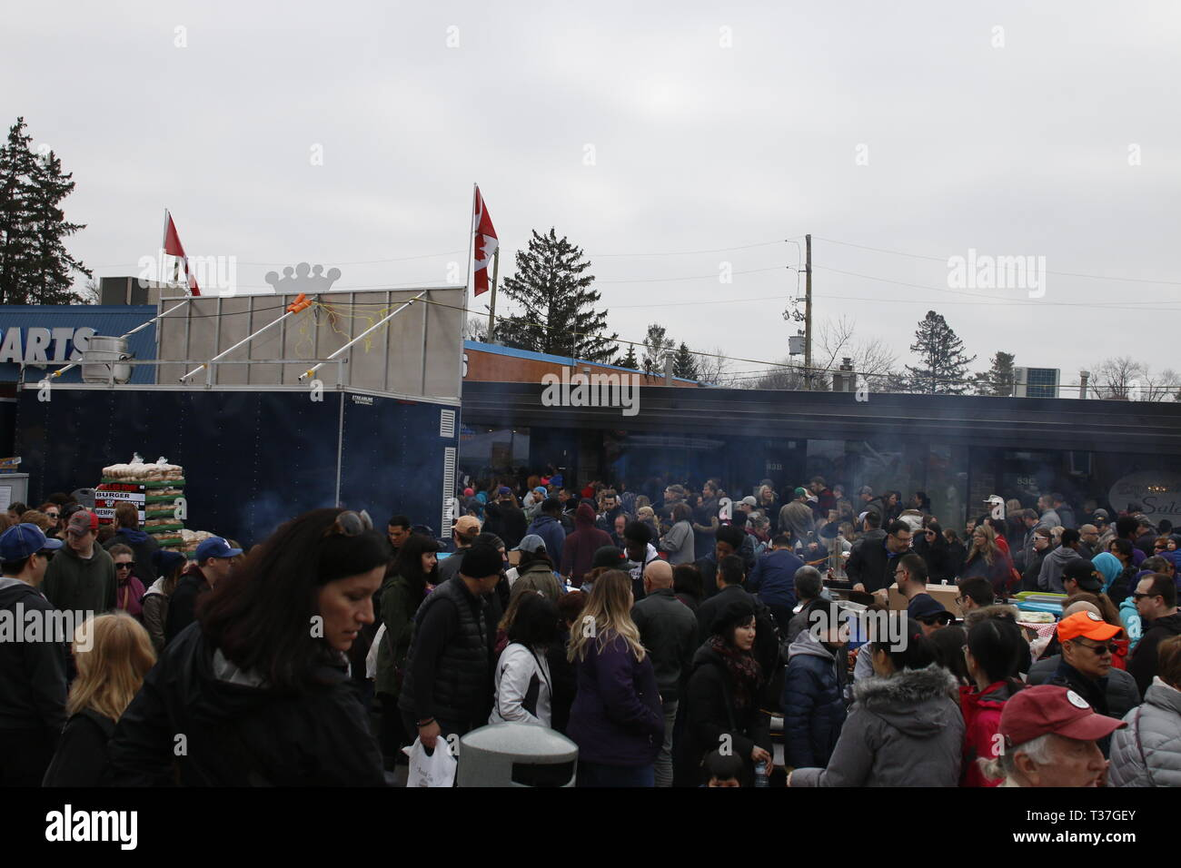 Elmira Canada, April 06 2019: editorial photograph of crowds of people at the Elmira Maple Syrup Festival. Photo showing the worlds largest maple - Stock Image