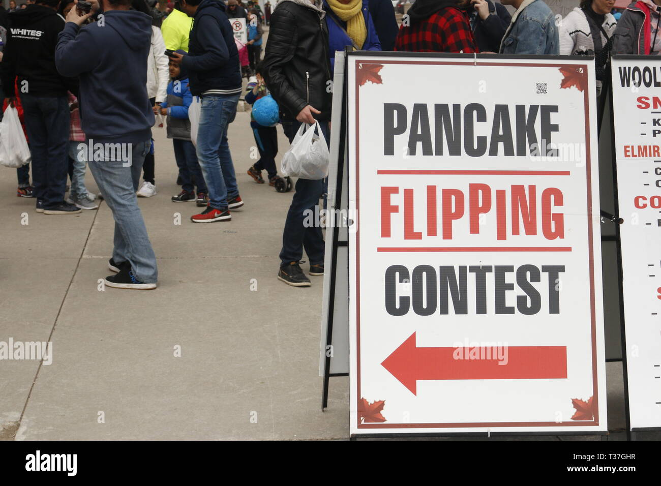 Elmira Canada, April 06 2019: editorial photograph of a pancake flipping contest sign. At the maple syrup festival there are lots of syrup themed fun - Stock Image