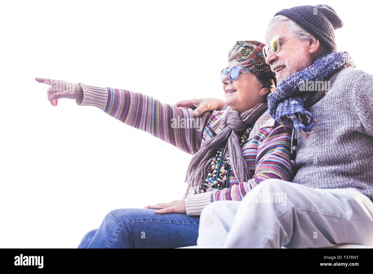 Happy cheerful people old senior caucasian couple smile and hug toegether with love and nice retired lifestyle outdoor leisure activity - white clear  Stock Photo