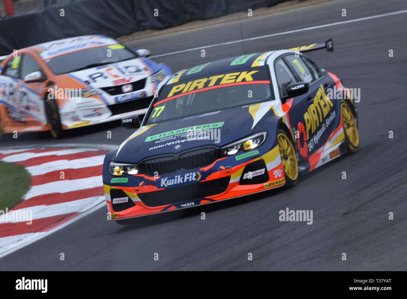 Andrew Jordans BMW 330i M-Sport touring car flying round druids with Sam Tordoffs car close behind. 6th april 2019, BTCC at brands hatch - Stock Image