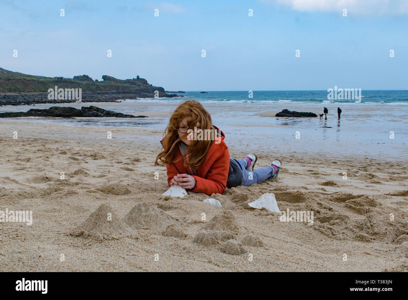 St Ives, Cornwall, UK. 7th April 2019.  The public were invited to cover the beach at St Ives with tiny mountains, made from moulds to represent Mount Kilmanjaro,  Shasta, Fuji, Stromboli and Ulura. Seen here Agatha Fitch.  The event today organised by the Tate St Ives is one of several taking place around the UK in conjunction with artist Katie Paterson. Credit: Simon Maycock/Alamy Live News Stock Photo