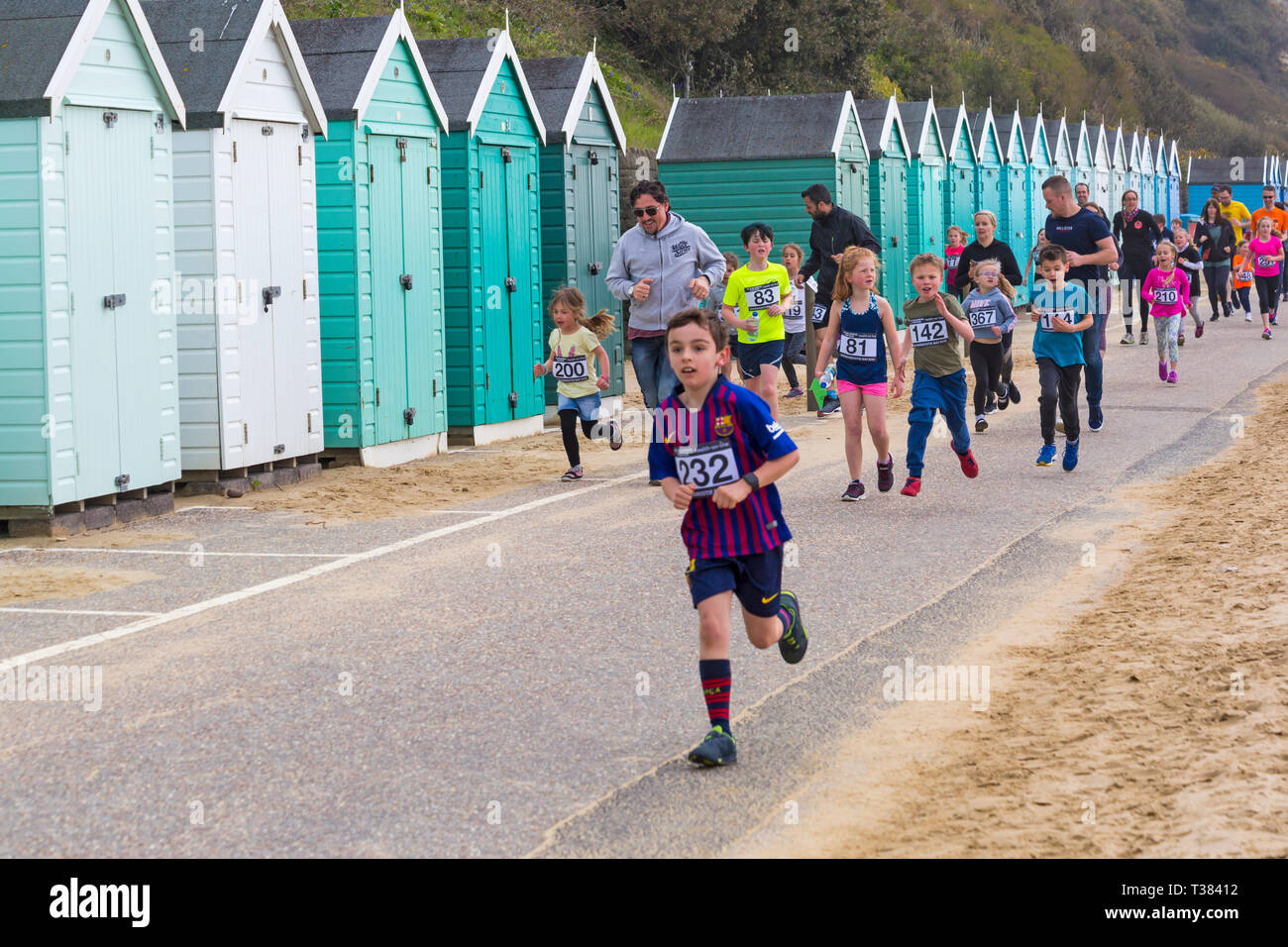 Bournemouth, Dorset, UK. 7th April 2019. Runners take part in the Bournemouth Bay Run on the theme of fun fairy-tale along Bournemouth's sea front - 1k Kids Fun Run. Participants run to raise vital funds for the British Heart Foundation charity to fight against heart disease. A dry day with hazy sunshine. Credit: Carolyn Jenkins/Alamy Live News - Stock Image